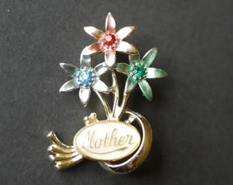 Mother brooch with pink blue and green flowers and mother of pearl