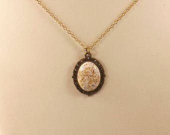 Gold flaked white natural stone pendant necklace. This is a perfect gift for that someone special in your life. Very nice buy!