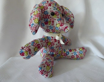 Individually hand made cuddly sitting elephant