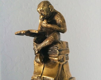 Pair of brass bookend chimpanzees