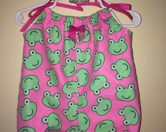 Frogs and Flannel Bubble Romper for baby girl, pink with green whimsical frog  faces , pink accent bow and ribbon for tieing at shoulder.