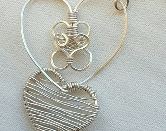 Hearts entwined pendant