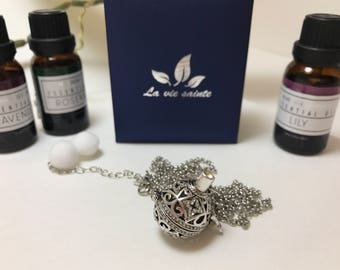 Cubic zirconia stainless steel essential oil locket with chain.