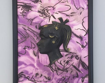 1960's metal head of a teenager on printed silk background