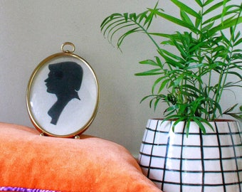 Vintage silhouette wall hanging in brass frame