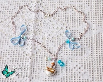 Necklace with pendant ampoule with glitter gold and white, enriched with flakes and pearls