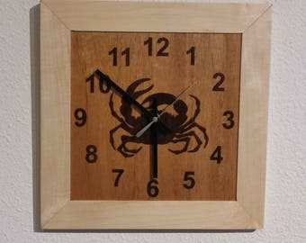 Dungeness crab clock, maple frame with laser-cut walnut veneer on mahogany background.