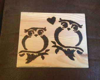 Owls in love hanging