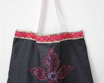 Embroidered and realized beach bag has hand