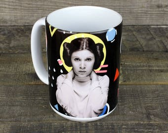 Princess Leia star wars MUG keeps your coffee HOT well keeps your coffee contained is more accurate but its  80s nostalgia and you want it