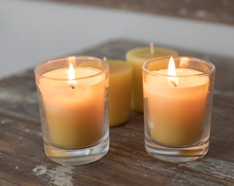 Set of 4 beeswax votive candles with 2 clear glass holders
