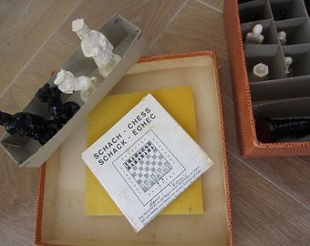 Vintage set of chess pieces in original box