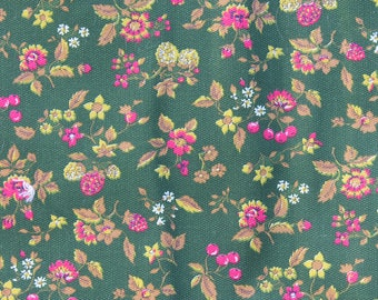 Screenprinted green cotton fabric with pattern of raspberries, berries, and flowers, magenta, light green, and brown, two and a half yards