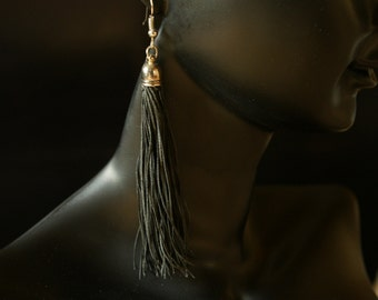 Hand made black leather tassel earrings Gyppo & Glitterati from France.