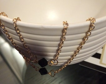 Double Strand Necklace with black bead  on a 14k gold plated Chain
