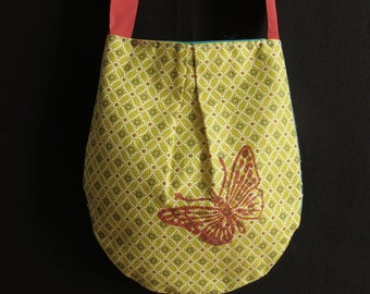 small pouch shoulder strap, green red ochre colors, printing of a butterfly, original linocut