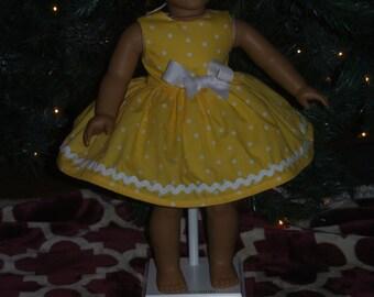 18 inch doll yellow poka dot dress.