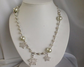 Snowflake necklace with a touch of holly