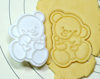 Bear holding a Heart Pendant Cookie Cutter and Stamp