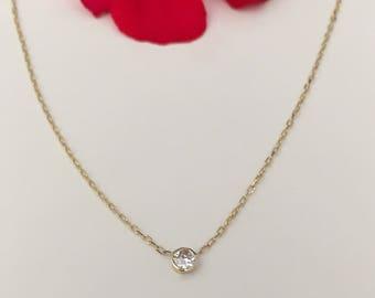 Dainty 14k bezel-set diamond solitaire pendant