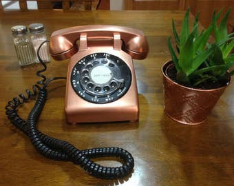 Copper vintage dial phone