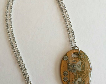 Homemade necklace charm from recycled computer parts