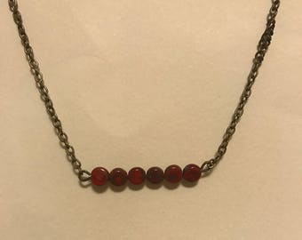 red line necklace