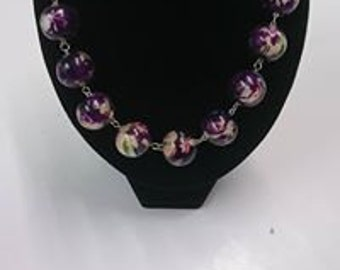 Purple flowered bead necklace