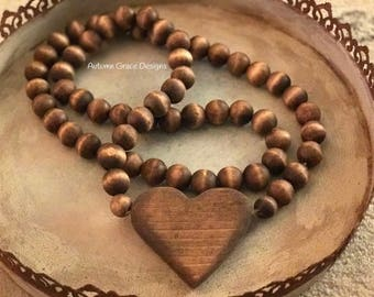 """36""""-38"""" long Handstained and cut heart wood bead garland/farmhouse beads/prayer beads"""