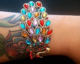 Costume jewelry bracelet with Peacock