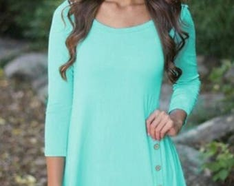 Mint colored top with button accents.