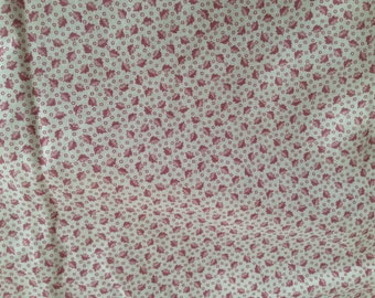 Cotton calico, quilting fabric, white background with rose colored leaves, 44 inches wide  1 3/4 tards long
