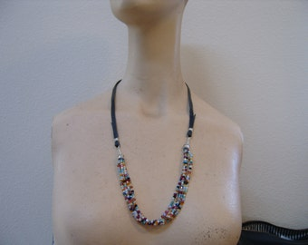 modern folk art necklace . . . no fasteners . . .sterling and swarovskis