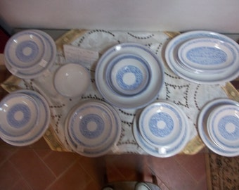 Turquoise, light blue, graffito of dishes served.