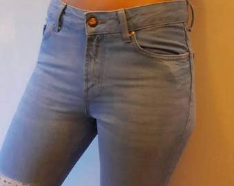 Upcycled and repaired ankle length jeans with vintage lace detail