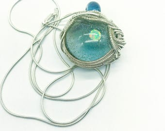 Wire wrapped dichro glass Opal pendant.