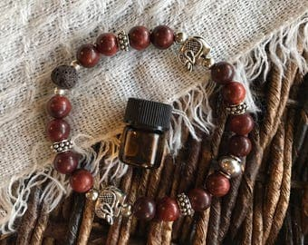 Rosewood and brown wood beemad diffuser bracelet with elephants!