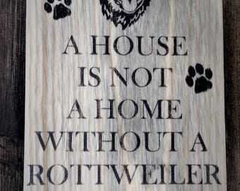 A house is not a home without / dog breed rustic sign