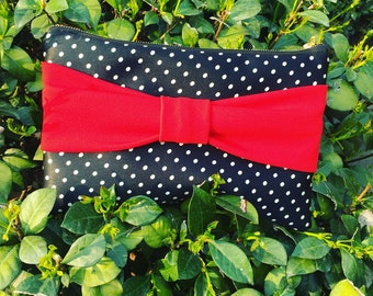 Polka dot clutch bag with bow handle