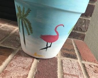 Flamingo and palm tree paradise terra-cotta planting pot