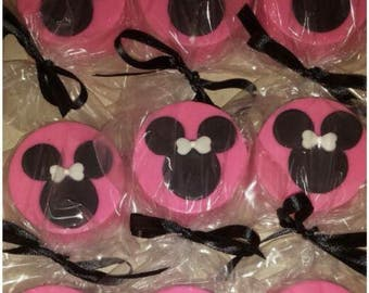 Chocolate dipped Minnie Mouse Oreos and pretzels!!