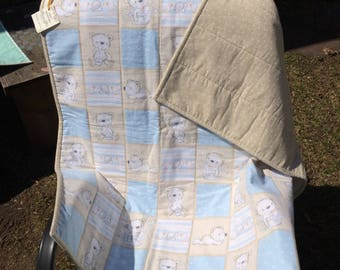 Beautiful handmade baby quilt made with soft cozy flannel material. Measures 37x40 in.