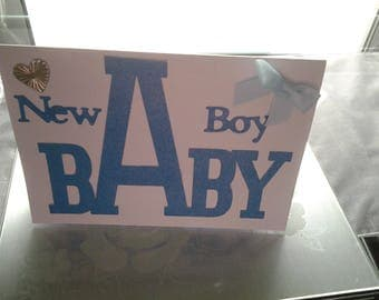 A 3D blue and white new baby boy card