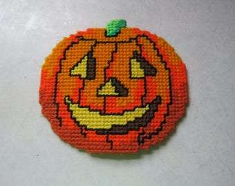 Halloween pumpkin Jack O Lantern made of plastic canvas and yarn with magnets on backside