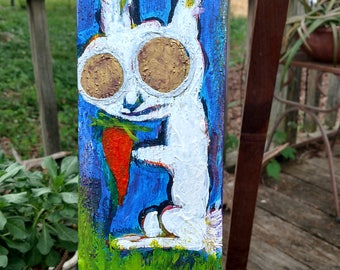 white rabbit with carrot and lost hole