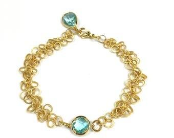 Bracelet with aquamarine crystal charm