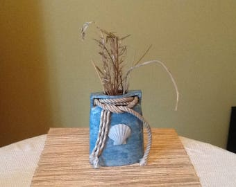 Shell and rope vase with sea grass
