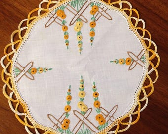 Vintage hand embroidered doily, 22 cm round, gold and yellow hollyhocks
