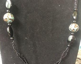 Black and green beaded necklace and earrings set