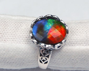 Ammolite ring.Deeply coloured faceted gem set in a gorgeous Sterling filigree in heart patterns.See body of listing for sizing info.